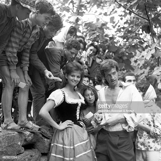 French actor Jean Paul Belmondo and Italian actress Claudia Cardinale signing autographs on the set of Cartouche France 1962