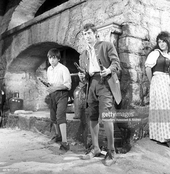 French actor Jean Paul Belmondo shooting two guns in Cartouche France 1962