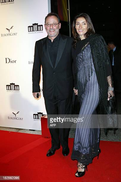 French actor Jean Reno and his wife Zofia arrive to attend the inauguration ceremony of the Cite du cinema a film studios complex heralded as...