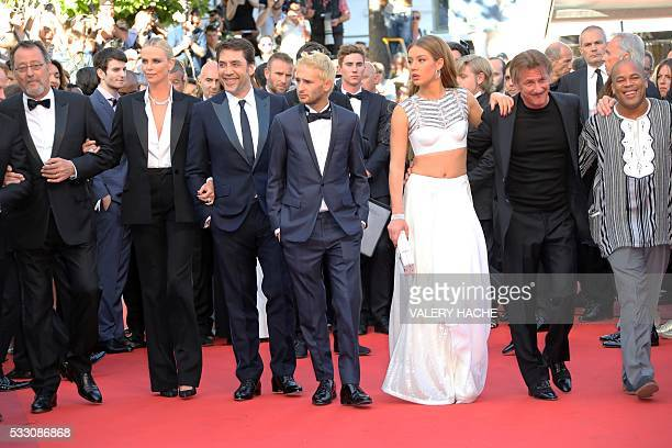 French actor Jean Reno South AfricanUS actress Charlize Theron Spanish actor Javier Bardem FSean Penn's son Hopper Jack Penn French actress Adele...