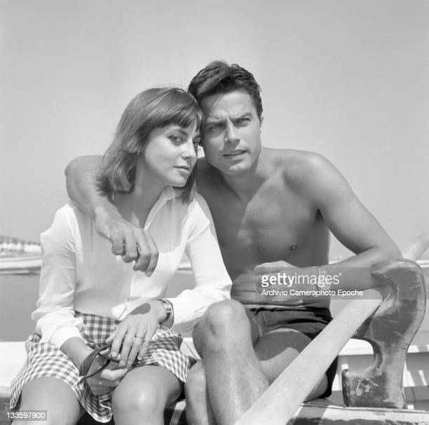 French actor Jean Sorel with his wife Anna Maria Ferrero sitting on a boat on the seashore Lido Venice 1967