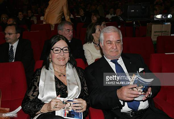 French actor JeanClaude Brialy and Greek singer Nana Mouskouri attend the opening ceremony of the Francophone cinema festival at the Attikon Cinemax...