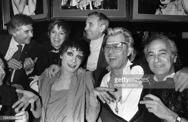 French actor JeanClaude Brialy US actress and singer Liza Minnelli French singer Charles Aznavour pose with tranvestite impersonator Silvestre Michou...