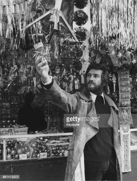 French actor JeanClaude Brialy visits a Christmas market in Rome Italy during the filming of 'A Season in Hell' December 1970 Brialy plays French...