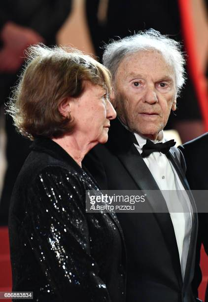 French actor JeanLouis Trintignant and his wife Marianne Hoepfner arrive on May 22 2017 for the screening of the film 'Happy End' at the 70th edition...