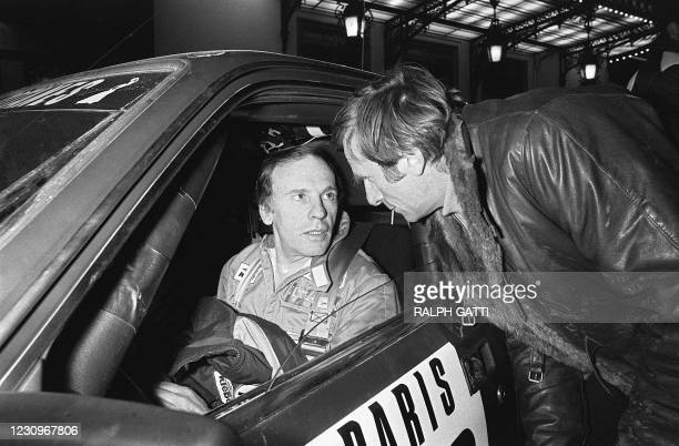 French actor Jean-Louis Trintignant chats on january 30, 1981 with his brother-in-law Christian Marquand during the 43rd Monte Carlo Rally.