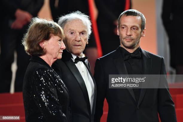 French actor JeanLouis Trintignant his wife Marianne Hoepfner and French actor Mathieu Kassovitz arrive on May 22 2017 for the screening of the film...