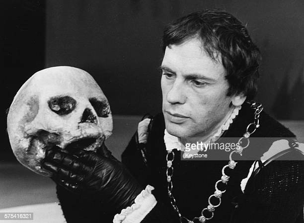 French actor JeanLouis Trintignant holding the skull of Yorik during a scene from the Shakespeare play 'Hamlet' Paris circa 1959