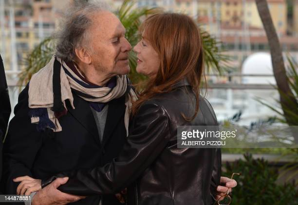 French actor JeanLouis Trintignant kisses French actress Isabelle Huppert during the photocall of 'Amour' presented in competition at the 65th Cannes...