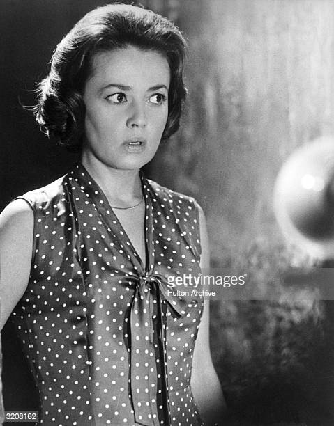 French actor Jeanne Moreau wears a polka-dotted blouse and a shocked expression in a still from the film 'The Train'.