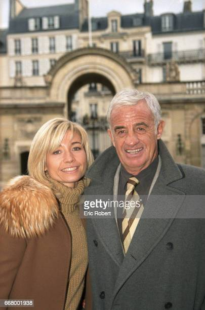 French actor JeanPaul Belmondo and his girlfriend Natty arrive at the Palais de l'Elysee French President Jacques Chirac presented the Legion of...