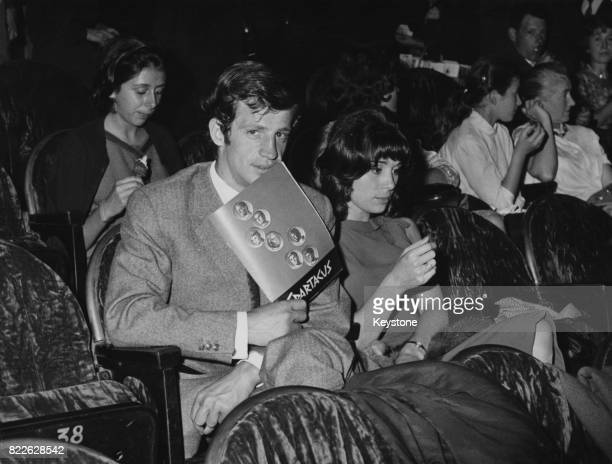 French actor JeanPaul Belmondo and his wife Élodie at the premiere of the film 'Spartacus' at the Gaumont Theatre in Paris France 15th September 1961