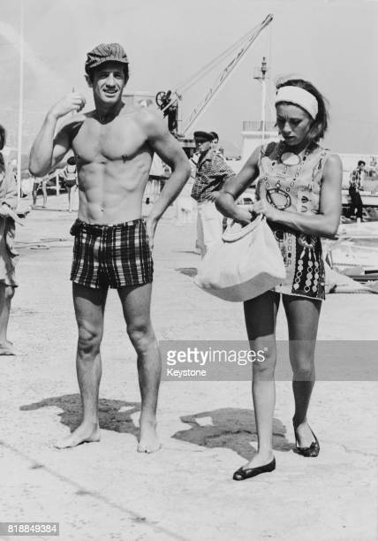 French actor JeanPaul Belmondo and his wife Élodie on holiday on the Cote d'Azur in France 14th August 1965