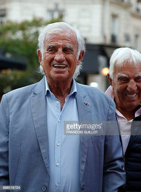 "French actor Jean-Paul Belmondo arrives with French actor Charles Gerard for being awarded of the ""Prix du singe"" in reference to the movie ""Un Singe..."