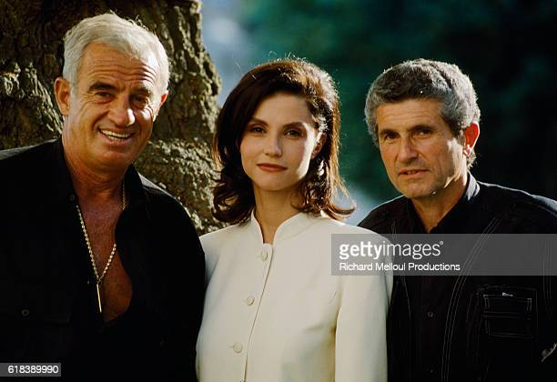 French actor Jean-Paul Belmondo, Italian actress Alessandra Martines and French director Claude Lelouch on the set of the 1995 French film Les Miserables.