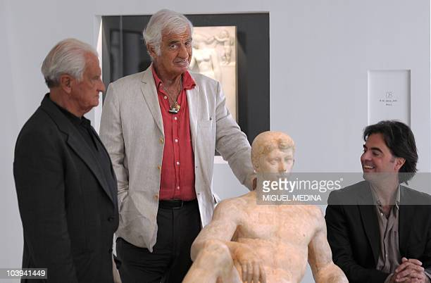 French actor JeanPaul Belmondo poses on September 9 2010 with his brother Alain Belmondo and his nephew Olivier Belmondo next to a sculpture created...