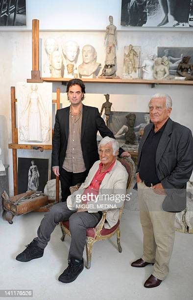 French actor JeanPaul Belmondo poses on September 9 2010 with his brother Alain Belmondo and his nephew Olivier Belmondo in the recreation of his...