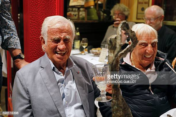 "French actor Jean-Paul Belmondo smiles next to French actor Charles Gerard after being awarded of the ""Prix du singe"" in reference to the movie ""Un..."