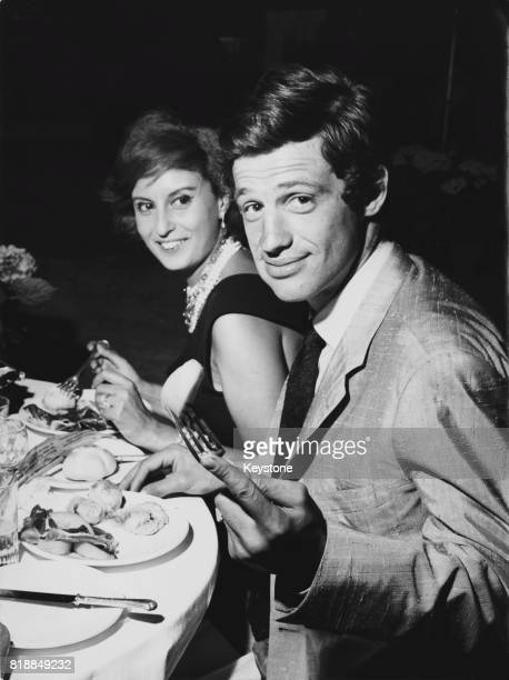 French actor JeanPaul Belmondo with a friend in the Via Veneto Rome Italy during the filming of 'Letters By a Novice' 1960