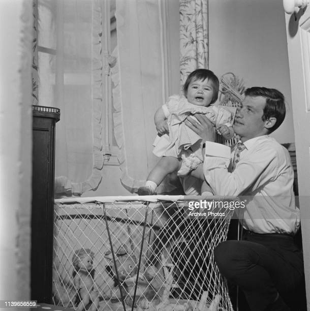 French actor JeanPaul Belmondo with a little girl circa 1960