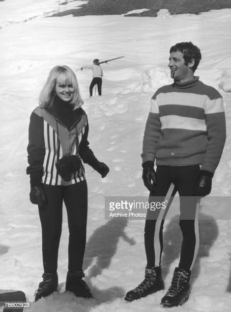 French actor JeanPaul Belmondo with actress Mylene Demongeot on the ski slopes of Megeve in the French Alps for the filming of 'Tendre Voyou' or...