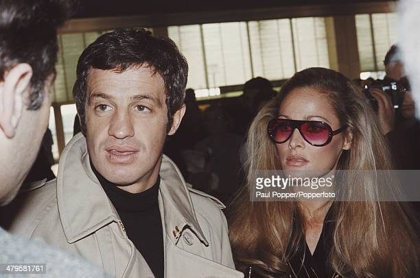 French actor JeanPaul Belmondo with his partner actress Ursula Andress at Orly Airport near Paris 29th November 1968 They are flying to the island of...