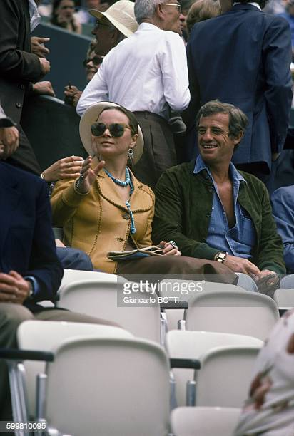 French actor JeanPaul Belmondo with partner Italian actress Laura Antonelli at Roland Garros in Paris France in June 1978