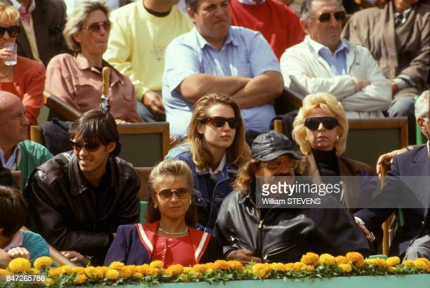 French actor JeanPaul Belmondo with partner Natty and son Paul at Roland Garros tennis stadium on June 4 1990 in Paris France