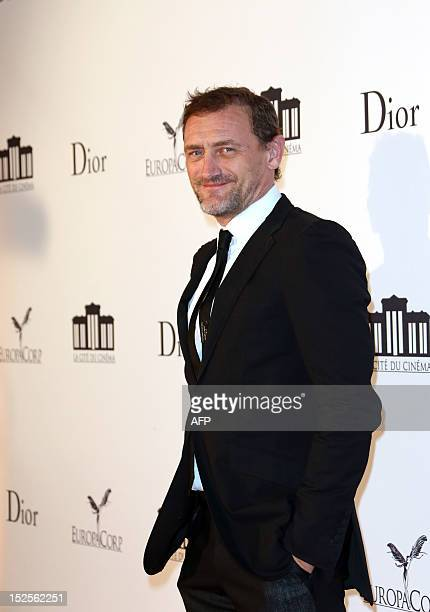 French actor JeanPaul Rouve poses as he arrives to attend the inauguration ceremony of the Cite du cinema a film studios complex heralded as...