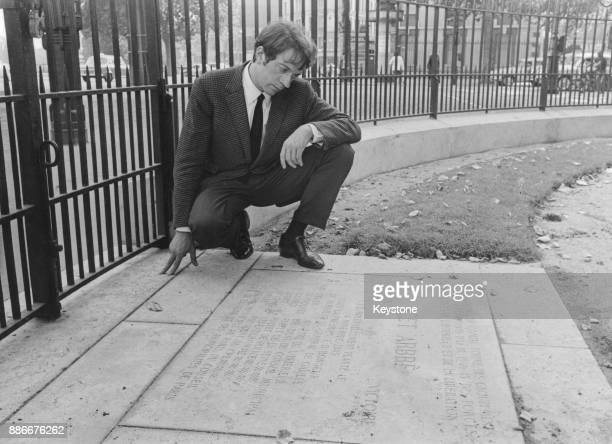French actor JeanPierre Cassel visits the plaque which commemorates the planting of a tree in Place de Stalingrad Paris by General de Gaulle to mark...