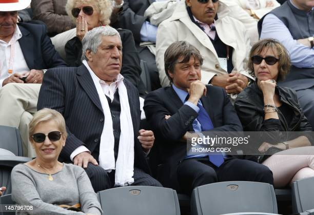 French actor JeanPierre Castaldi attends a tennis match during the French Open tennis tournament at the Roland Garros stadium on June 6 2012 in Paris...