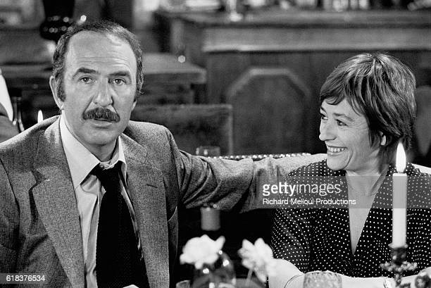 French actor Jean-Pierre Marielle jokes with actress Annie Girardot. The two actors starred in the 1976 film Cours apres moi que je t'attrape,...