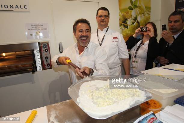 French actor Jose Garcia promoting his new movie Gino at Pizza Show Porte de Versailles in Paris France on March 29 2011 Here pictured with Bruno...