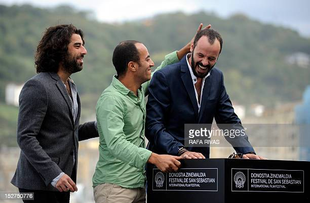French actor Karim Saleh and Palestinian actors Ali Suliman and Ramzi Maqdisi pose during a photocall after the screening of the film 'The Attack' by...