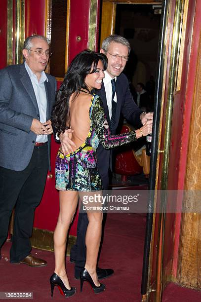 French Actor Lambert Wilson and Sandra Zeitoun attend 'L'Amour Dure Trois Ans' Paris Premiere at Le Grand Rex on January 7 2012 in Paris France