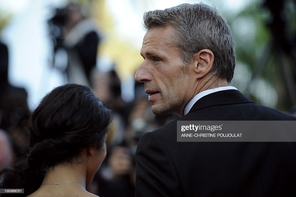 French actor Lambert Wilson (R) arrive for the screening of 'Des Hommes et des Dieux' (Of God and Men) presented in competition at the 63rd Cannes Film Festival on May 18, 2010 in Cannes.