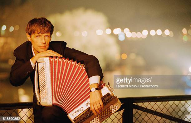 French Actor Lambert Wilson Holding an Accordion