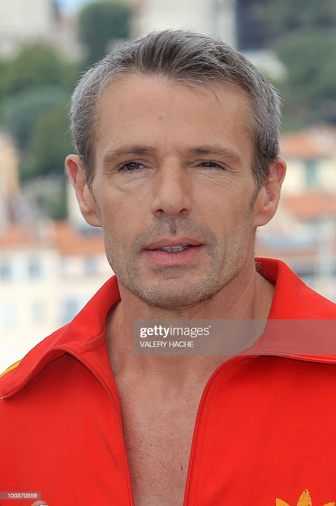 French actor Lambert Wilson poses during the photocall of 'Des Hommes et des Dieux' (Of God and Men) presented in competition at the 63rd Cannes Film Festival on May 18, 2010 in Cannes.