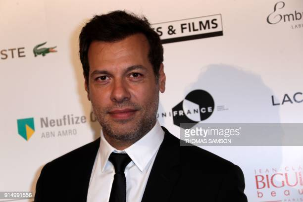 French actor Laurent Lafitte poses as he arrives to attend the 25emes Trophees du Film Français awards ceremony at The Palais Brongniart in Paris on...