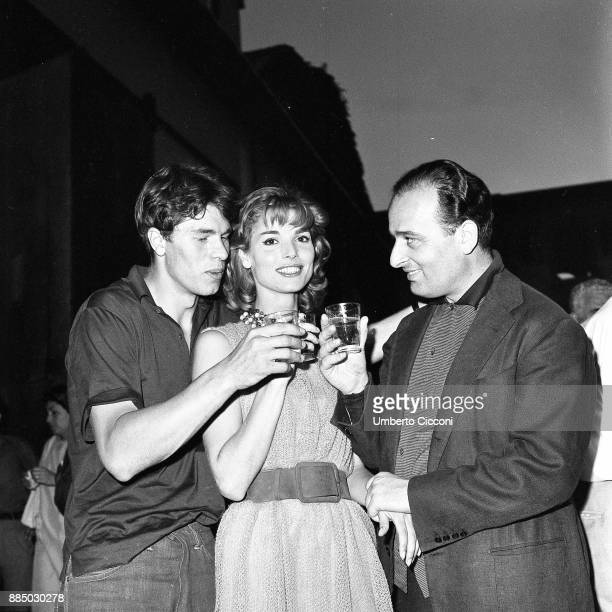 French actor Laurent Terzieff Italian actress Elsa Martinelli and Italian film and stage director Mauro Bolognini makes a toast in Rome 1959