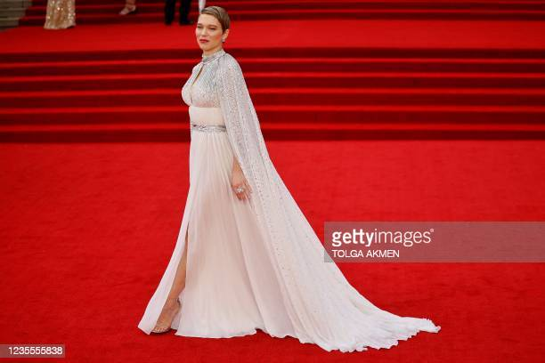 """French actor Lea Seydoux poses on the red carpet after arriving to attend the World Premiere of the James Bond 007 film """"No Time to Die"""" at the Royal..."""
