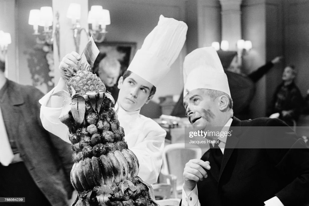 French actor Louis de Funes and his son, actor Olivier de Funes on the set of Le Grand Restaurant (What's Cooking in Paris), written and directed by Jacques Besnard.
