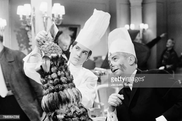 French actor Louis de Funes and his son actor Olivier de Funes on the set of Le Grand Restaurant written and directed by Jacques Besnard