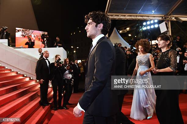 French actor Louis Garrel arrives with French actress Chrystele Saint-Louis Augustin and French actress and director Maiwenn for the screening of the...