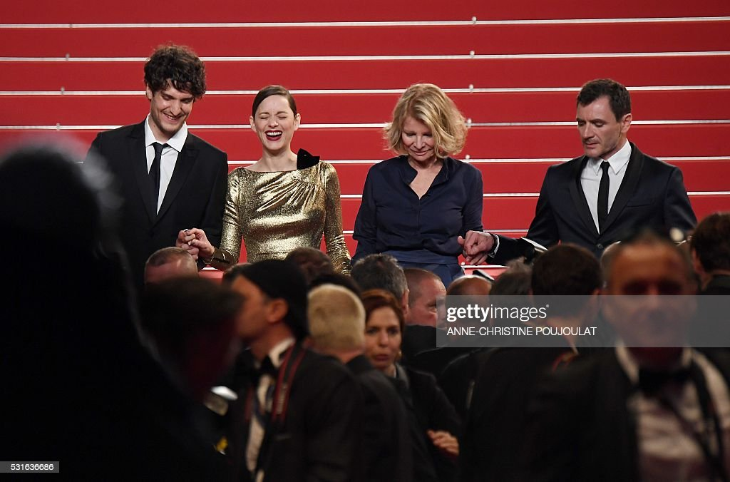 TOPSHOT - (From L) French actor Louis Garrel, French actress Marion Cotillard, French director Nicole Garcia and Spanish actor Alex Brendemuhl leave after the screening of the film 'Mal de Pierres (From the Land of the Moon)' at the 69th Cannes Film Festival in Cannes, southern France. / AFP / ANNE