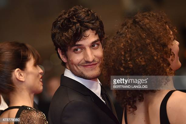 """French actor Louis Garrel smiles as he arrives for the screening of the film """"Mon Roi"""" at the 68th Cannes Film Festival in Cannes, southeastern..."""