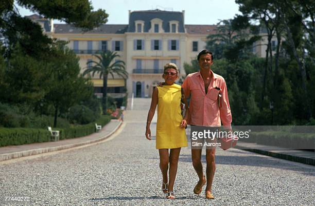 French actor Louis Jourdan and his wife Quiquie at the Eden Roc annex of the Hotel Du Cap D'Antibes on the French Riviera August 1969