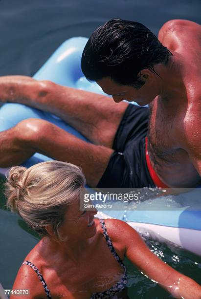 French actor Louis Jourdan and his wife Quiquie in the pool at the Hotel du Cap EdenRoc Antibes France August 1969