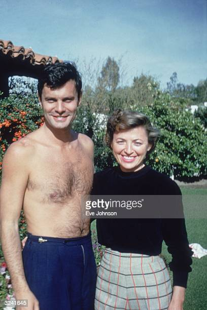 French actor Louis Jourdan poses without a shirt next to Quique Jourdan Palm Springs California