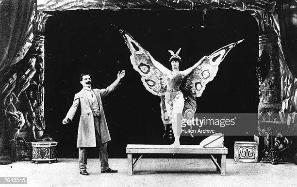 French actor magician designer and theatre manager Georges Melies in a film in which he turns a sleeping woman into a butterfly